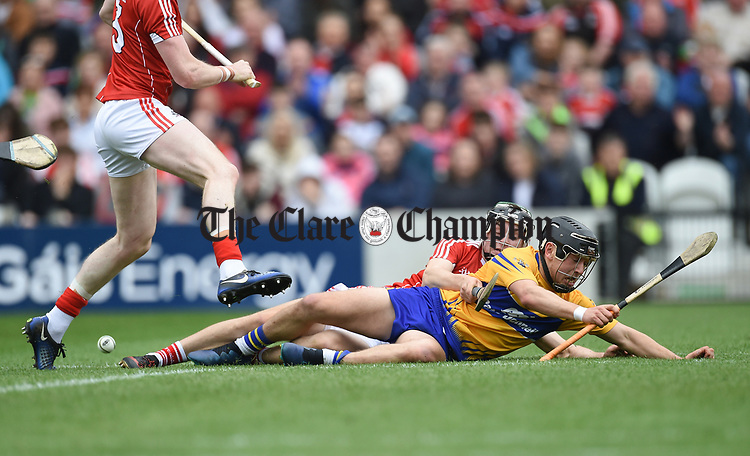 David Reidy of Clare in action against Mark Coleman of Cork during their Munster Senior game at Pairc Ui Chaoimh. Photograph by John Kelly.