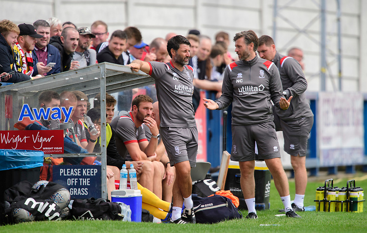 Lincoln City manager Danny Cowley, left, and Lincoln City's assistant manager Nicky Cowley watch on from the technical area<br /> <br /> Photographer Chris Vaughan/CameraSport<br /> <br /> Football Pre-Season Friendly (Community Festival of Lincolnshire) - Lincoln City v Lincoln United - Saturday 6th July 2019 - The Martin & Co Arena - Gainsborough<br /> <br /> World Copyright © 2018 CameraSport. All rights reserved. 43 Linden Ave. Countesthorpe. Leicester. England. LE8 5PG - Tel: +44 (0) 116 277 4147 - admin@camerasport.com - www.camerasport.com