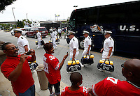 From left: Deron Hendrick, of Sacramento, CA, Kim Bradley, of Baltimore, Deron's son Toure Hendrick, 10, and Kim's husband Tim Bradley wear the jersey of their nephew Ohio State Buckeyes linebacker Joshua Perry (37) and watch as the Navy players walk off the busses and enter the stadium before the college football game between the Ohio State Buckeyes and the Navy Midshipmen at M&T Bank Stadium in Baltimore, Saturday morning, August 30, 2014. (The Columbus Dispatch / Eamon Queeney)