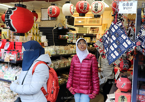 January 10, 2017, Tokyo, Japan - International tourists stroll the Nakamise shopping street of Asakusa district in Tokyo on Tuesday, January 10, 2017. The government announced that the number of foreign tourists visiting Japan reached a record high of 24 million in 2016. (Photo by Yoshio Tsunoda/AFLO)