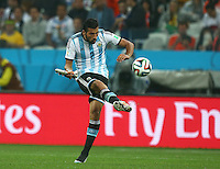 Ezequiel Garay of Argentina clears the ball wearing only one boot
