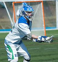 Paul D'Anneo, '16, defends against Endicott in SRU Men's Lacrosse game action at Gaudet Field in Middletown.