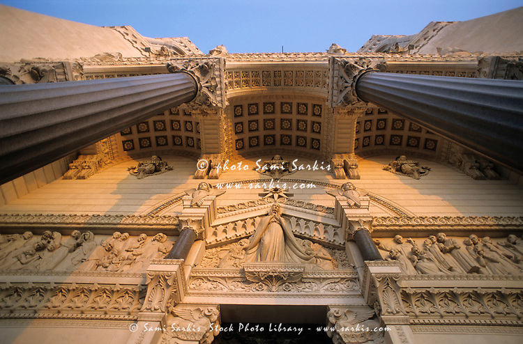Ornate facade of the Basilica of Notre-Dame de Fourviere at sunset, Fourviere, Lyon, France.