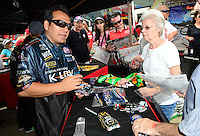 Jun. 29, 2012; Joliet, IL, USA: NHRA funny car driver Tony Pedregon signs die cast models during qualifying for the Route 66 Nationals at Route 66 Raceway. Mandatory Credit: Mark J. Rebilas-