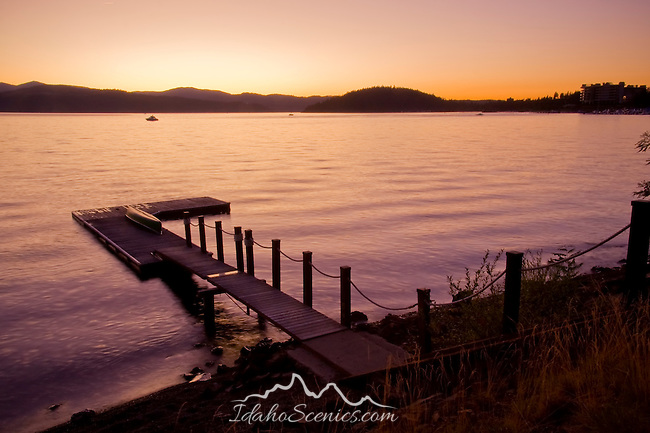 Idaho, North, Coeur d'Alene.The last light of a summer day fades into purple over a canoe and dock on Lake Coeur d'Alene.