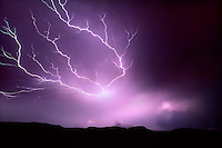 """Cloud to cloud lightning known as """"Anvil Crawlers"""" light up a desolate landscape near Girvin in southwest Texas."""