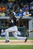 Tim Anderson (87) of the Chicago White Sox follows through on his swing against the Charlotte Knights at BB&T Ballpark on April 3, 2015 in Charlotte, North Carolina.  The Knights defeated the White Sox 10-2.  (Brian Westerholt/Four Seam Images)
