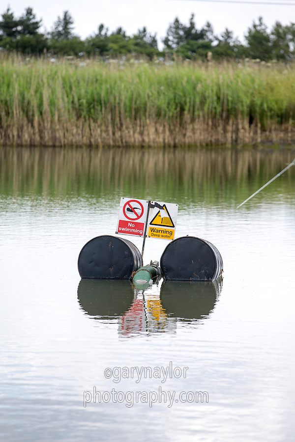 Warning signs in irrigation reservoir - Lincolnshire, June