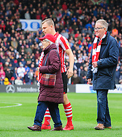 Lincoln City's Harry Anderson with one of the club's 'older mascots' prior to kick off<br /> <br /> Photographer Chris Vaughan/CameraSport<br /> <br /> The EFL Sky Bet League Two - Lincoln City v Crewe Alexandra - Saturday 6th October 2018 - Sincil Bank - Lincoln<br /> <br /> World Copyright &copy; 2018 CameraSport. All rights reserved. 43 Linden Ave. Countesthorpe. Leicester. England. LE8 5PG - Tel: +44 (0) 116 277 4147 - admin@camerasport.com - www.camerasport.com