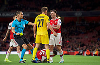 Referee Sandro Schärer approaches Kieran Tierney of Arsenal & Mergim Vojvoda of Standard Liege during the UEFA Europa League match between Arsenal and Standard Liege at the Emirates Stadium, London, England on 3 October 2019. Photo by Andrew Aleks.
