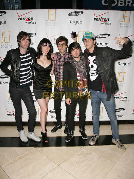 COBRA STARSHIP.Lauren Bosworth hosts the Verizon Wireless Samsung Rogue Launch Event at Jet Nightclub inside the Mirage Resort Hotel and Casino, Las Vegas, Nevada, USA..October 26th, 2009.Gabe Saporta Ryland Blackinton Alex Suarez Victoria Asher Nate Novarro full length band group jeans denim black t-shirt dress.CAP/ADM/MJT.© MJT/AdMedia/Capital Pictures.
