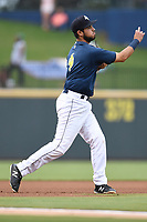 Third baseman Rigoberto Terrazas (9) of the Columbia Fireflies plays defense in a game against the Greenville Drive on Sunday, May 27, 2018, at Spirit Communications Park in Columbia, South Carolina. Greenville won, 3-0. (Tom Priddy/Four Seam Images)