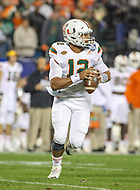 Charlotte, NC - December 2, 2017: Miami Hurricanes quarterback Malik Rosier (12) rolls out to attempt a pass during the ACC championship game between Miami and Clemson at Bank of America Stadium in Charlotte, NC.  (Photo by Elliott Brown/Media Images International) Clemson defeated Miami 38-3 for their third consecutive championship title.
