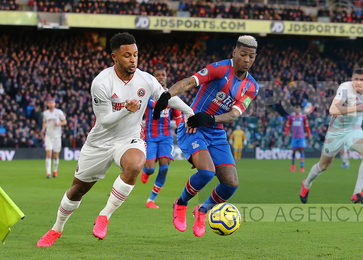 Lys Mousset of Sheffield Utd tussles with Patrick van Aanholt of Crystal Palace during the Premier League match at Selhurst Park, London. Picture date: 1st February 2020. Picture credit should read: Paul Terry/Sportimage