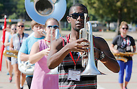 NWA Democrat-Gazette/DAVID GOTTSCHALK   Ralph Miller practices marching with the mellophone Thursday, August 13, 2015 with the Razorback Marching Band Leadership Team on the campus of the University of Arkansas in Fayetteville. Miller was selected as a returning member of the band to participate in the four day camp that is stressing marching fundamentals that will be passed along to the entire 350 member band. The Razorback Marching Band is now under the direction of first year director Ben Lorenzo.