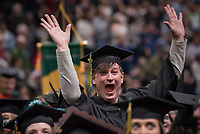 Travis Jennings, B.S. Biological Sciences, celebrates before receiving his degree during UAA's 2019 Spring Commencement at the Alaska Airlines Center.