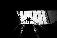 Daytime landscape view of Two Women Riding An Escalator out of a Metro station in Shanghai.  © LAN