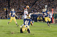 Safety Matthias Farley (41) downs a Notre Dame punt near the 5-yard line in the third quarter.