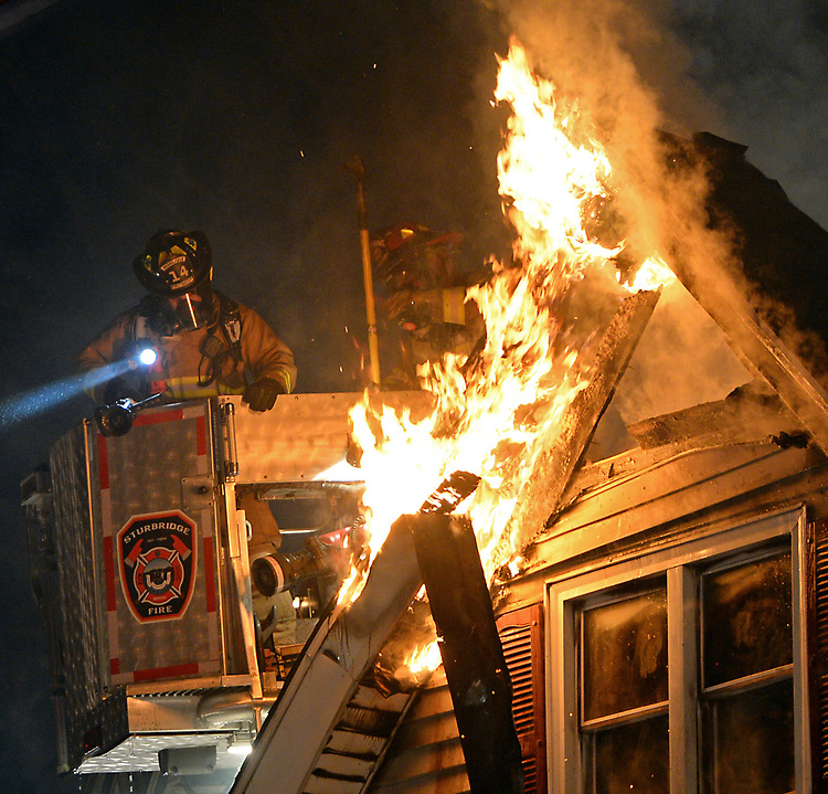 (Sturbridge, MA, 12/20/17) Firefighters battle a five-alarm fire in a building along Brookfield Road in Sturbridge on Wednesday, December 20, 2017. Photo by Christopher Evans