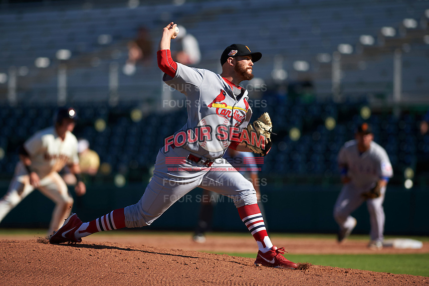 Surprise Saguaros pitcher Robby Rowland (99) delivers a pitch during an Arizona Fall League game against the Scottsdale Scorpions on October 22, 2015 at Scottsdale Stadium in Scottsdale, Arizona.  Surprise defeated Scottsdale 7-6.  (Mike Janes/Four Seam Images)