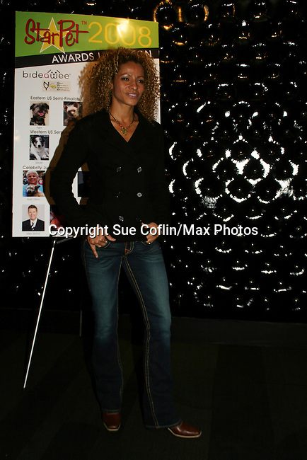 Actress Michelle Hurd now on Gossip Girl & was on Another World at the First Annual StarPet 2008 Awards Luncheon as dogs and cats compete for a career in showbusiness on November 10, 2008 at the Edison Ballroom, New York, New York. The event benefitted Bideawee and NY SAVE. (Photo by Sue Coflin/Max Photos
