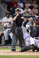 Home plate umpire Sean Barber makes a strike call during the International League game between the Indianapolis Indians and the Charlotte Knights at BB&T BallPark on June 16, 2017 in Charlotte, North Carolina.  The Knights defeated the Indians 12-4.  (Brian Westerholt/Four Seam Images)