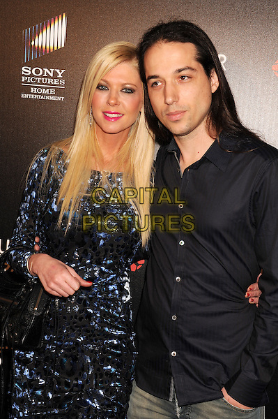 HOLLYWOOD, CA - FEBRUARY 11: Tara Reid &amp; Erez Eisen attends the premiere of 'The Hungover Games' at the TCL Chinese 6 Theatres on February 11, 2014 in Hollywood, California.<br /> <br /> CAP/LNC/JM<br /> &copy;JM/LNC/Capital Pictures