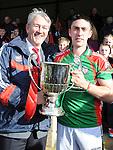 Glen Emmets captain Stephen Healy with winning trophy. Photo: Colin Bell/Pressphotos.ie