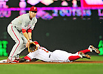 28 September 2010: Philadelphia Phillies' second baseman Chase Utley receives a throw but is unable to get a diving Nyjer Morgan out at second during a game against the Washington Nationals at Nationals Park in Washington, DC. The Nationals defeated the Phillies 2-1 on an Adam Dunn walk-off solo homer in the 9th inning to even up their 3-game series one game apiece. Mandatory Credit: Ed Wolfstein Photo
