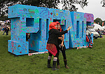 Two girls with red hair wigs take a self portrait by the Electric Picnic Sign, Stradbally, Laois, Ireland.