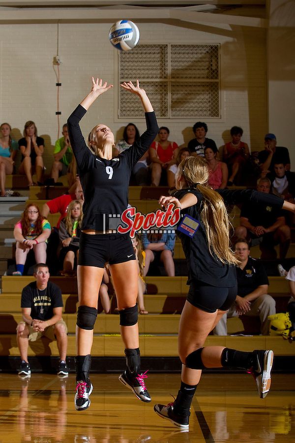 Danae Rosendall (9) of the Wake Forest Demon Deacons sets the ball against the Davidson Wildcats in Reynolds Gymnasium on September 1, 2012 in Wake Forest, North Carolina.  The Demon Deacons defeated the Wildcats 3-2.   (Brian Westerholt / Sports On Film)