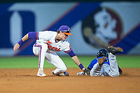 Kennie Taylor (15) of the Duke Blue Devils is tagged out by Clemson Tigers shortstop Logan Davidson (8) as he tries to steal second base in Game Three of the 2017 ACC Baseball Championship at Louisville Slugger Field on May 23, 2017 in Louisville, Kentucky.  The Blue Devils defeated the Tigers 6-3.. (Brian Westerholt/Four Seam Images)