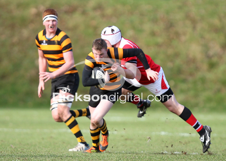 SCHOOLS CUP 2015  | Saturday 7th February 2015<br /> <br /> Ethan Harbinson during the third round of the 2015 Ulster Schools Cup between RBAI and Regent House at Osborne Park, Belfast.<br /> <br /> Picture credit: John Dickson / DICKSONDIGITAL