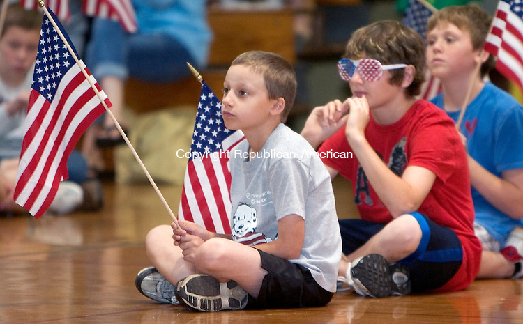 TORRINGTON, CT. 15 June 2010-061510SV06--From left, Eric Baccei, 11, and Jimmy Lamanna, 11, hold flags while listening to vets during Flag Day ceremonies at East Elementary School in Torrington Monday.<br /> Steven Valenti Republican-American