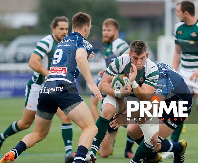 Ealing's Arthur Ellis is tackled by Bedford's William Carrick-Smith and Thomas James  during the Greene King IPA Championship match between Ealing Trailfinders and Bedford Blues at Castle Bar , West Ealing , England  on 29 October 2016. Photo by Carlton Myrie / PRiME Media