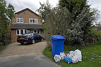 Household dustbin placed on front garden ready for collection..©shoutpictures.com..john@shoutpictures.com