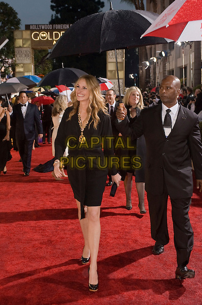 JULIA ROBERTS .Arrivals at the 67th Golden Globe Awards held Beverly Hilton, Beverly Hills, California, USA..January 17th, 2010.globes full length black dress patent shoes gold necklace clutch bag umbrella .CAP/AW/HFPA.Supplied by Anita Weber/Capital Pictures