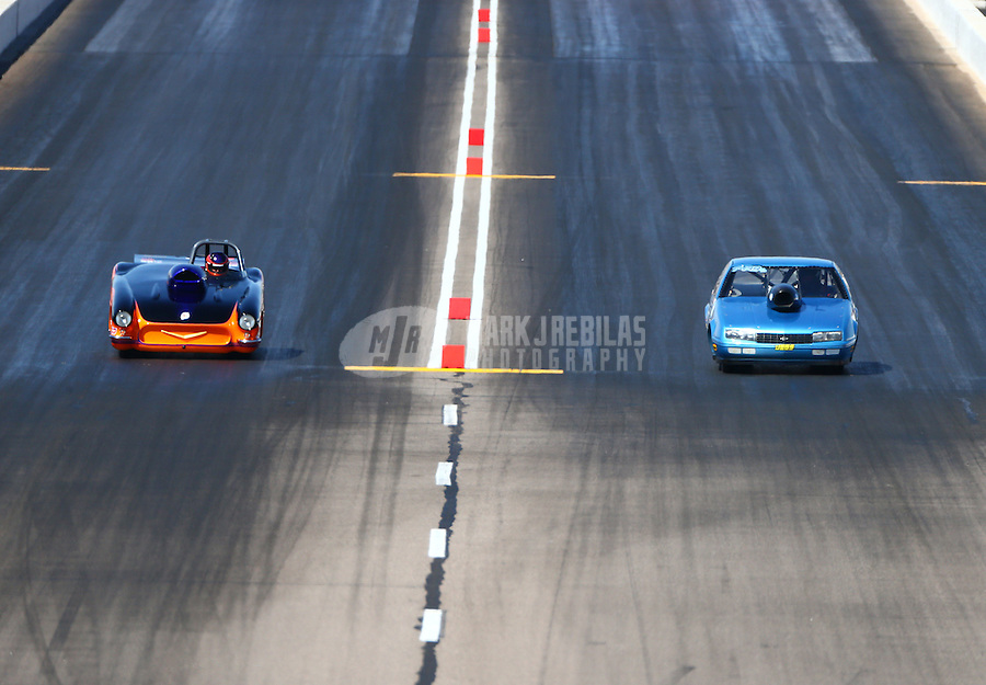 Feb 28, 2016; Chandler, AZ, USA; NHRA super gas driver Mike Lang (left) against Clint Fishel during the Carquest Nationals at Wild Horse Pass Motorsports Park. Mandatory Credit: Mark J. Rebilas-