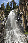 Palisade Falls at Hyalite Canyon of the Gallatin National Forest in Bozeman Montana. Sweeping falls cascading down two levels of rock. Vertical shot