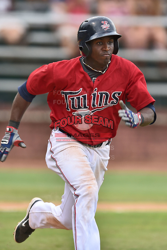 Elizabethton Twins right fielder Jeremias Pineda #5 runs to first during a game against the  Bristol Pirates at Joe O'Brien Field June 30, 2014 in Elizabethton, Tennessee. The Twins defeated the Pirates 8-5 in game one of a double header. (Tony Farlow/Four Seam Images)
