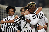 Juventus' Paulo Dybala, back to camera, celebrates with teammates Juan Cuadrado, left, Claudio Marchisio and Paul Pogba, right, after scoring the winning goal during the Italian Serie A football match between Juventus and Roma at Juventus Stadium. Juventus won 1-0.