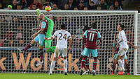 James Collins of West Ham United challenges his own goalkeeper Adrian before the two square up to each other during the Barclays Premier League match between Swansea City and West Ham United played at The Liberty Stadium, Swansea on 20th December 2015