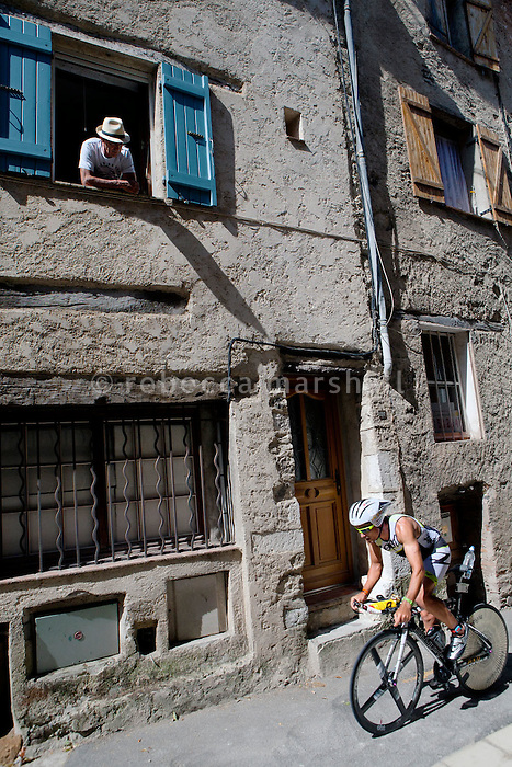 A triathlete passes through the village of Greolieres during Ironman France 2012, Nice, France, 24 June 2012