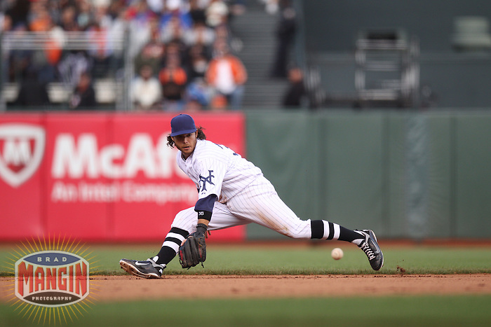 SAN FRANCISCO, CA - JUNE 2:  Brandon Crawford #35 of the San Francisco Giants makes a play at shortstop against the Chicago Cubs during the game at AT&T Park on Saturday, June 2, 2012 in San Francisco, California. Photo by Brad Mangin