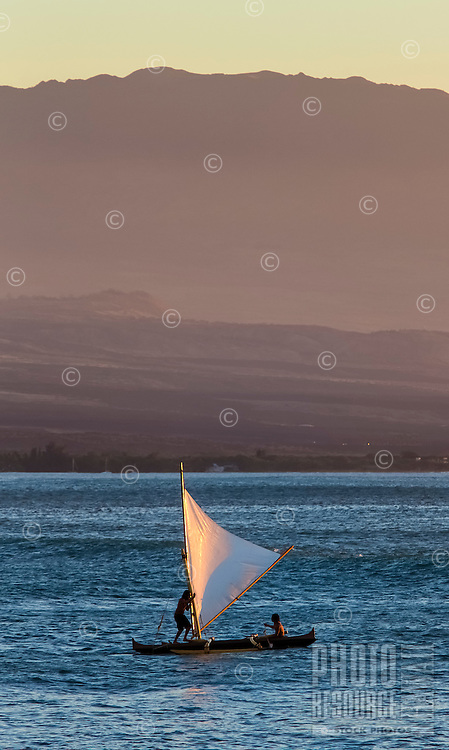 Canoe sailors off the Kohala Coast on the Big Island; Hualalai looms in the distance.