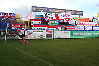 Kenny Beaney of Kingstonian takes a corner in front of the travelling Kingstonian fans flags during Macclesfield Town vs Kingstonian, Emirates FA Cup Football at the Moss Rose Stadium on 10th November 2019