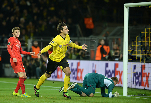 07.04.2016. Dortmund, Germany.  Dortmund's Mats Hummels (C) celebrates the equalizing goal next to Liverpool's goalkeeper Simon Mignolet (R) during the Europa League match between Dortmund and FC Liverpool at Signal Iduna Park in Dortmund, Germany, 07 April 2016.