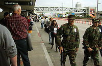 Nov 11, 2001 - Los Angeles, California, USA - National Guard troops walk past a line of waiting travelers at Los Angeles International Airport Sunday Nov. 11, 2001. The people at right are walking to the end of the line to get into the airport security checkpoint. The line stretched from terminal one all the way to terminal two and took about an hour to navigate. ( © Alan Greth)