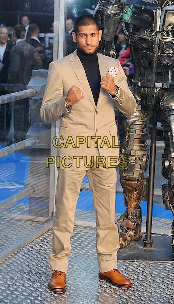 """Amir Khan .""""Real Steel"""" - UK film premiere held at the Empire Leicester Square - Arrivals..London, England..September 14th, 2011.full length beige stubble black suit jacket beard facial hair hands fists .CAP/BEL.©Tom Belcher/Capital Pictures."""