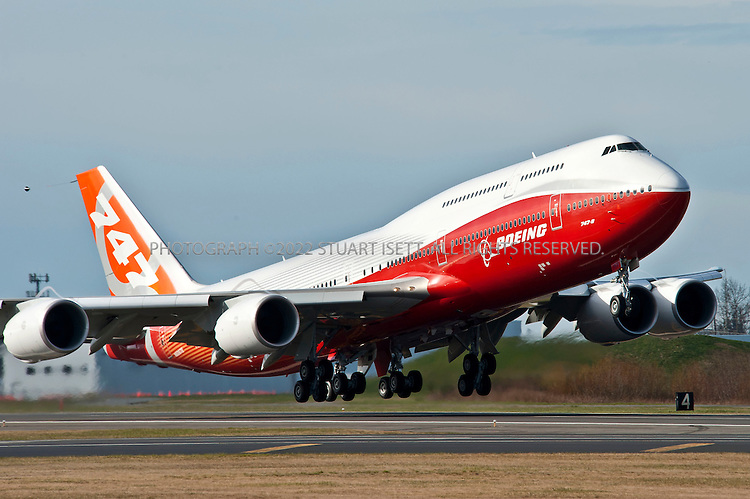 3/20/2011--Everett, WA, USA..The first successful test flight for Boeing's new 747-8 wide-body commercial jet airliner took place at Paine Field north of Seattle. Officially announced in 2005, the 747-8 is the fourth-generation Boeing 747 version, with lengthened fuselage, redesigned wings and improved efficiency. The 747-8 is the largest 747 version, the largest commercial aircraft built in the United States, and the longest passenger aircraft in the world...The 747-8 is offered in two main variants: the 747-8 Intercontinental (747-8I) for passengers and the 747-8 Freighter (747-8F) for cargo...©2011 Stuart Isett. All rights reserved.